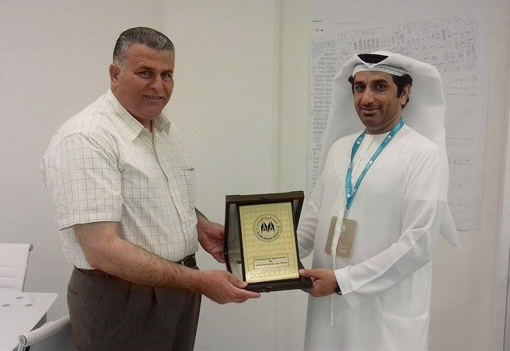 Honoring Director of the Book Authority in Abu Dhabi International book fair Abdullah Majid AL-Ali with the university shield