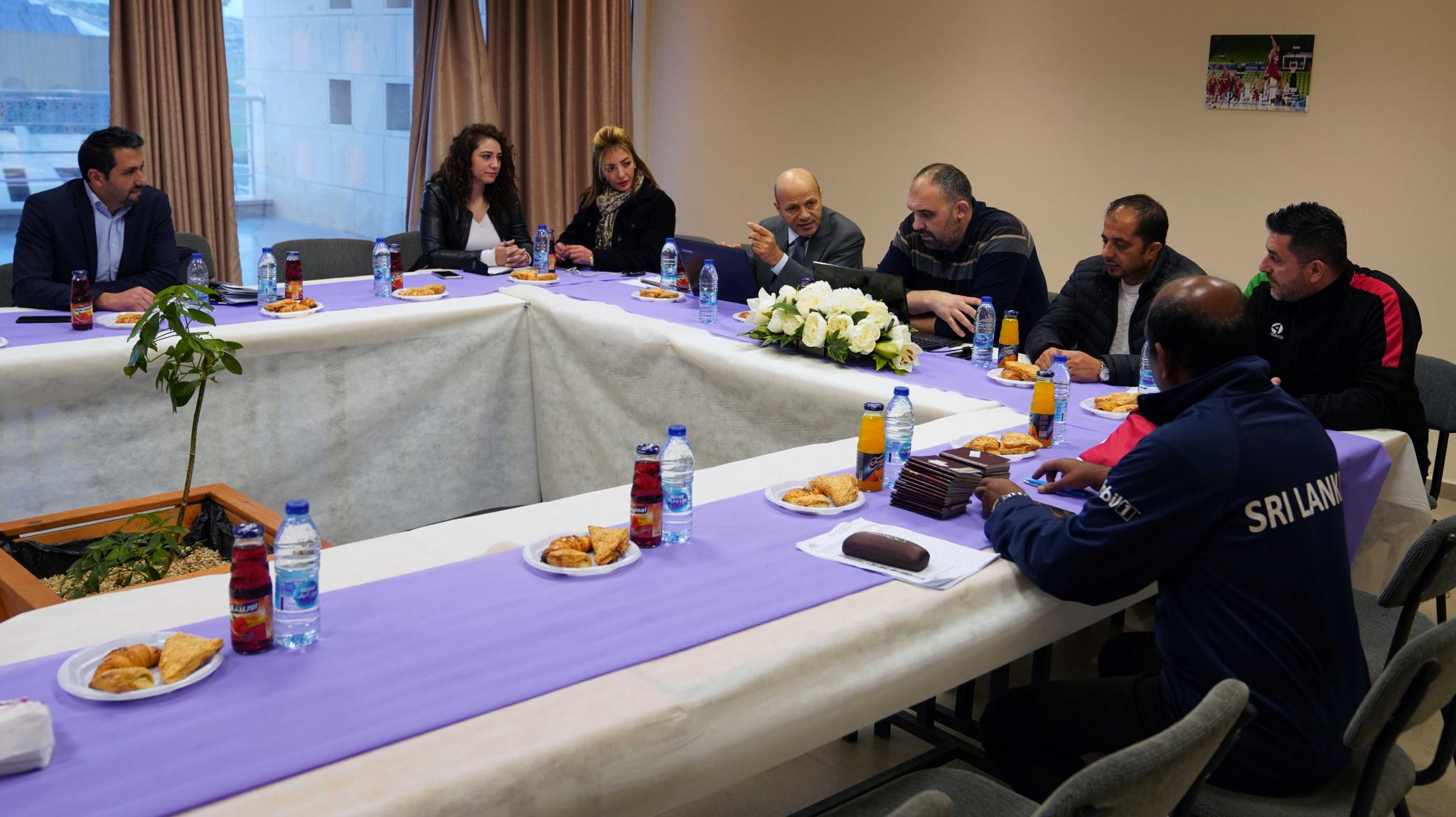 A Meeting before the International Basketball Game in AAUP