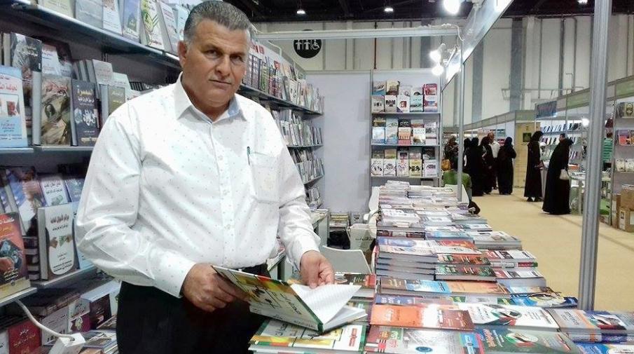 Director of the university library Mr. Hasan Al-Said in Abu Dhabi International book fair