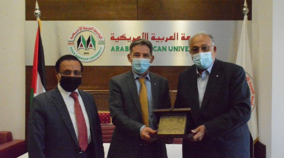 The Chairman of the Board of Directors, Dr. Yousef Asfour and Prof. Ali Zeidan Abu Zuhri- the University President while honoring the Head of the Anti-Corruption Commission, Mr. Ra'id Radwa.