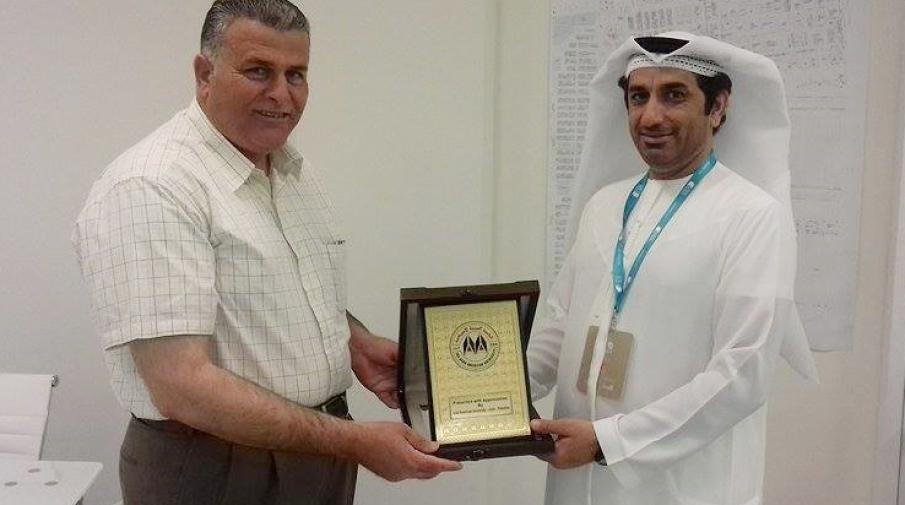 Honoring Director of the Book Authority in Abu Dhabi International book fair Abdullah Majid AL-Ali with the university shield