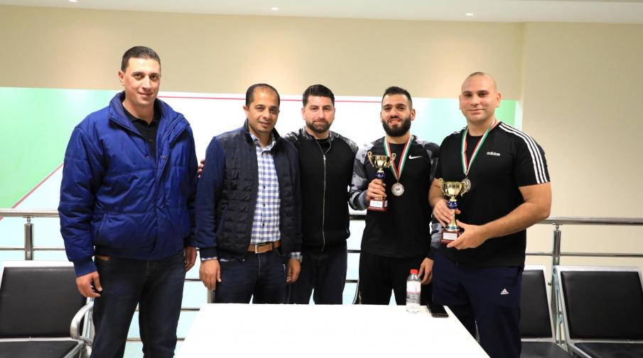 Honoring the winners in the first and second places in the squash championship in AAUP