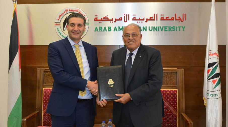"Prof. Ali Zeidan Abu Zuhri- the University President and Mr. Abdul Majeed Melhem- the General Manager of PALTEL ""Jawwal"""
