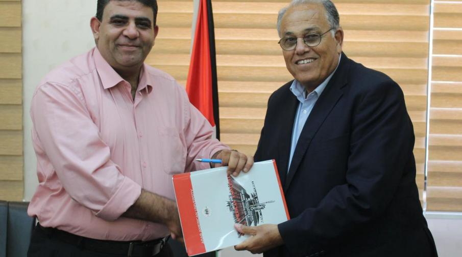 University President Prof. Dr. Ali Zeidan Abu Zuhri and the Red Crescent Society Tubas's center Manager Nidal Odeh