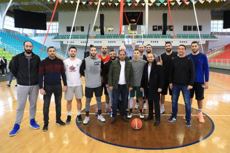 The Palestinian Basketball team with the training crew with Eng. Bara Asfour- the Assistant to the President and Mr. Uday Daraghmeh- the Director of Sports Facilities.