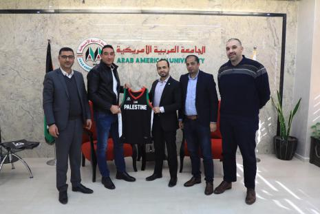 The Head of the Palestinian basketball federation giving Eng. Asfour the shirt of Al Feda'i team as a national symbolic gift to express his appreciation for the efforts that AAUP does in supporting the Palestinian sports in general and the basketball sport in specific.