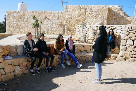 Interior Architecture students of AAUP while listening to an explanation about the old town of Kofor Aqab in their field trip to the place