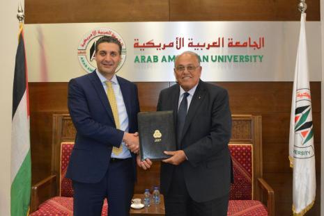 "Prof. Ali Zeidan Abu Zuhri- the University President and Mr. Abdul Majeed Melhem- the General Manager of PALTEL ""Jawwal"""