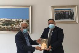 The Ambassador of the Embassy of India gifting a book about the life of Gandhi to AAUP