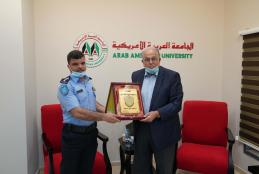 Brigadier Azzam Jbara- the Police Chief of Jenin honoring Prof. Ali Zeidan Abu Zuhri- the university President with the police shield.
