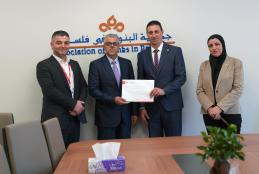 The Public Relations Department in AAUP Hands Master's Degree Scholarship Notes to Palestinian Organizations