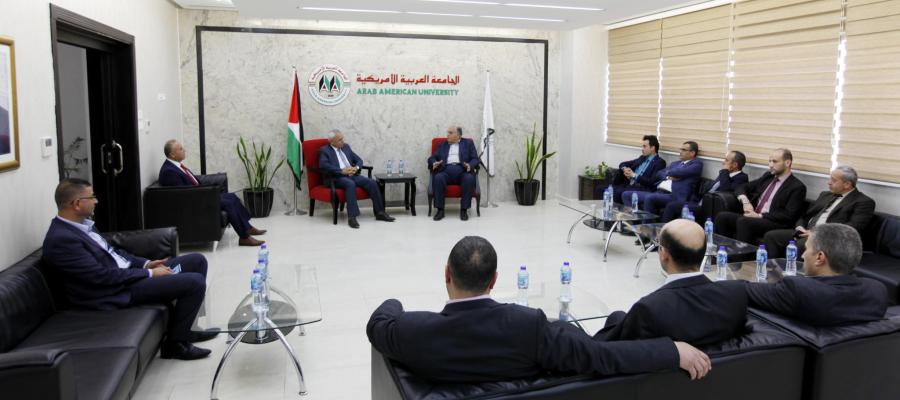 University President Prof. Dr. Ali Zeidan Abu Zuhri welcoming the President of Land and Water Settlement Authority Minister Judge Mousa Shakarneh